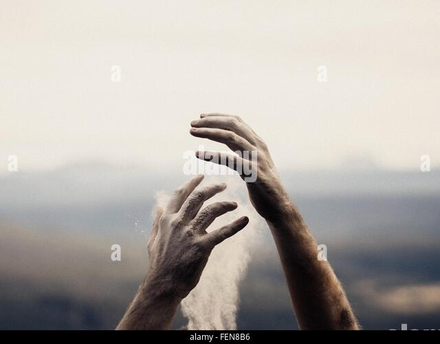Cropped Hand Touching Smoke - Stock Image