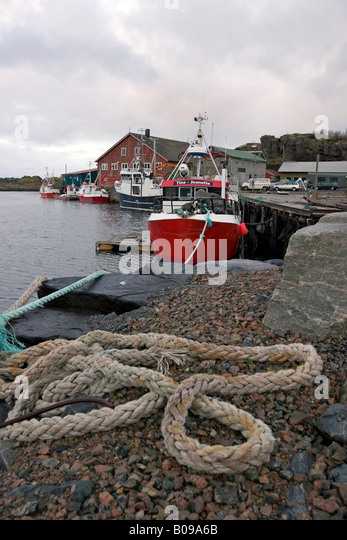 Fishing boats on a quay in Strønstad, Lofoten, Norway - Stock Image