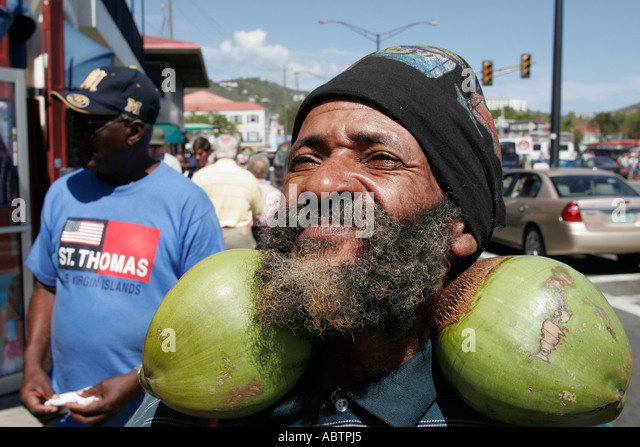 St. Thomas USVI Charlotte Amalie Waterfront Drive Black male coconuts - Stock Image