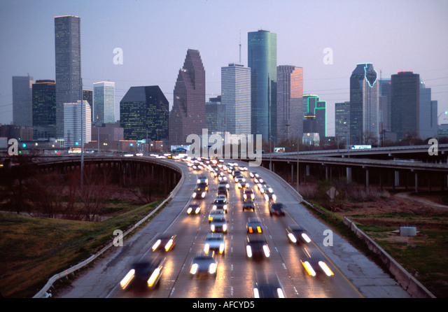 Texas The Southwest Houston Interstate 45 commuter rush hour traffic city skyline beyond dusk TX006 - Stock Image