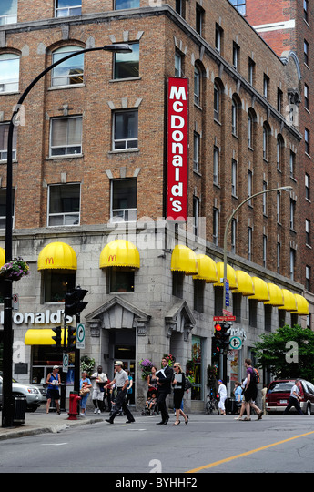 McDonalds Restaurant At Rue Notre Dame And Boulevard Saint Laurent Montreal Canada - Stock Image