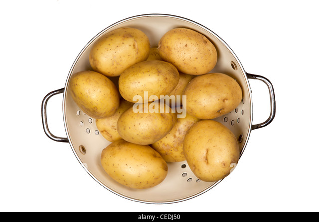 Potatoes in colander - Stock Image