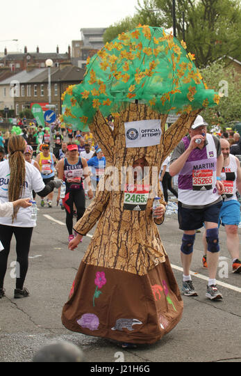 London, UK. 23rd Apr, 2017.  A runner dresses as a tree seen close to the 17 mile mark at Madchutte during the 37th - Stock Image