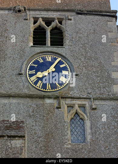 Clockface at St Marys, East Ilsley, Berkshire, England,UK - Stock Image