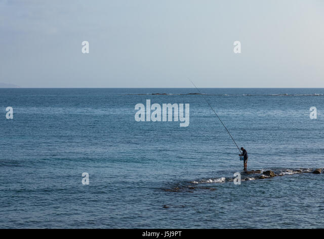 Lebanese man fishing on rocks, South Governorate, Tyre, Lebanon - Stock-Bilder