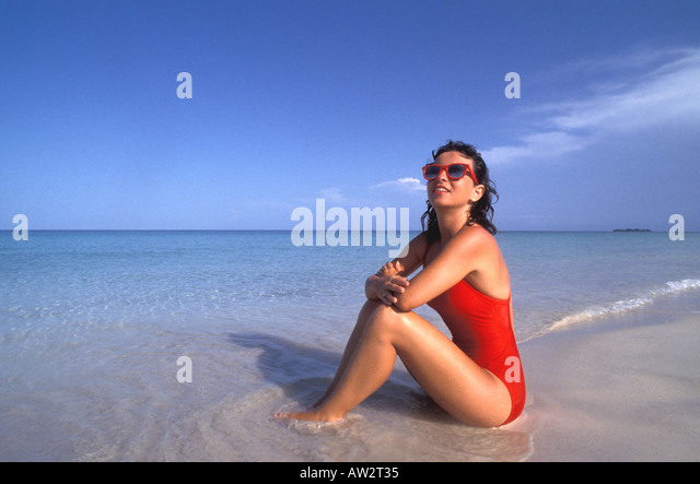 Jamaica Negril Beach Woman in Red Bathing Suit - Stock Image