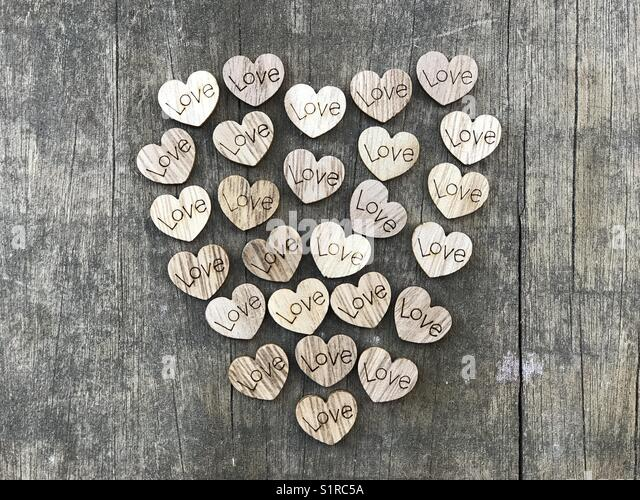 Cloud of love wooden hearts - Stock Image