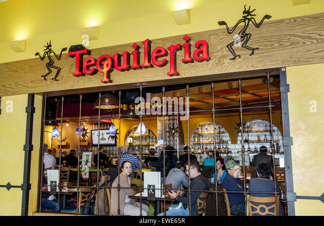 Charlotte North Carolina Charlotte Douglas International Airport inside terminal concourse gate area Tequileria - Stock Image