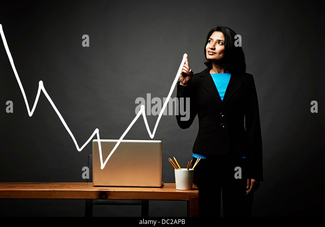 Woman drawing line graph - Stock-Bilder