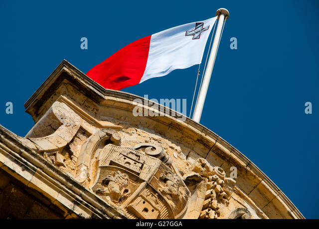 Maltese flag flying over the Auberge de Castelle, Prime Ministers Office, Valletta the capital of Malta - Stock Image