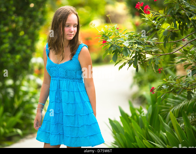 Teen-girl in the spring garden. - Stock Image