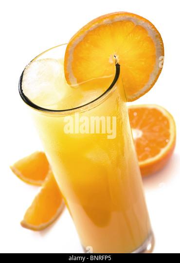 Glass of icy orange juice with orange slice (isolated against white) - Stock Image