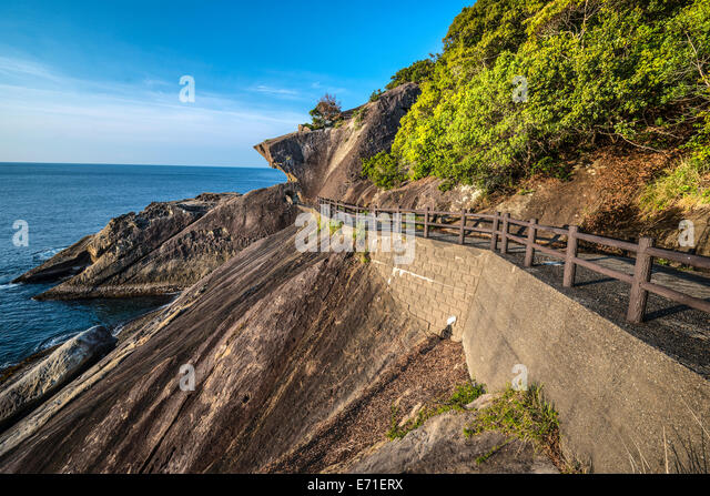 Kumano, Japan coast line at Onigajo 'Devil's Castle' rocks on the coastline. - Stock Image