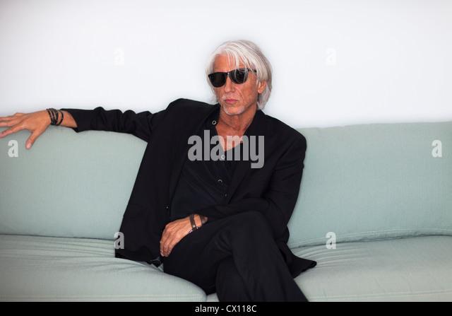 Portrait of cool mature man in sunglasses - Stock-Bilder