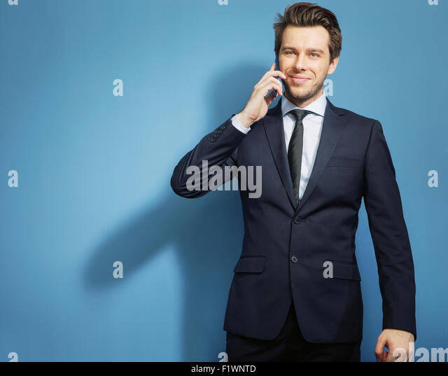 Smart guy talking by the mobile phone - Stock Image