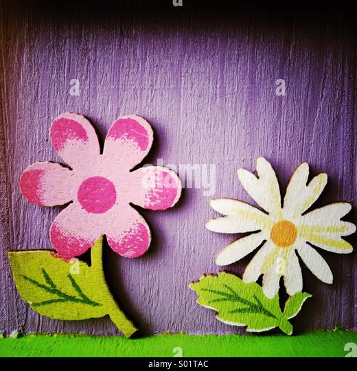 Painted wood flowers - Stock Image