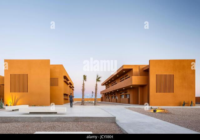 View of campus at dawn. Laayoune Technology School, Laayoune, Morocco. Architect: Saad El Kabbaj, Driss Kettani, - Stock-Bilder