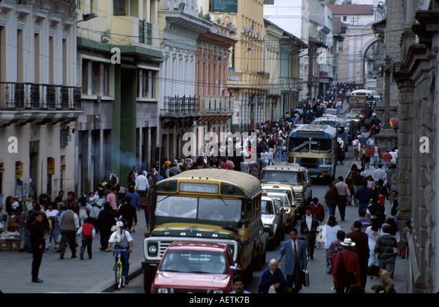 Ecuador Quito Colonial District Gabriel Garcia Moreno Street traffic pedestrians bus - Stock Image