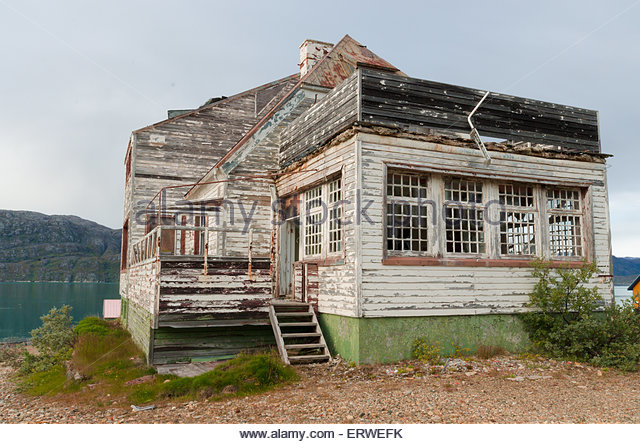 An old abandoned haunted house in the old Ivittuut mine village in Greenland - Stock Image