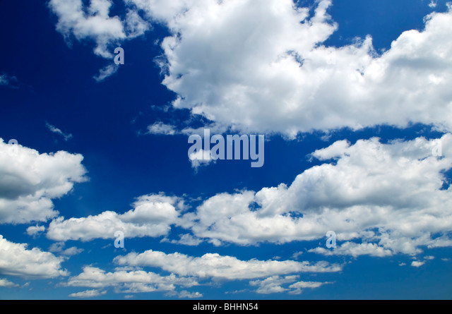 Background of blue sky with white cumulus clouds - Stock Image