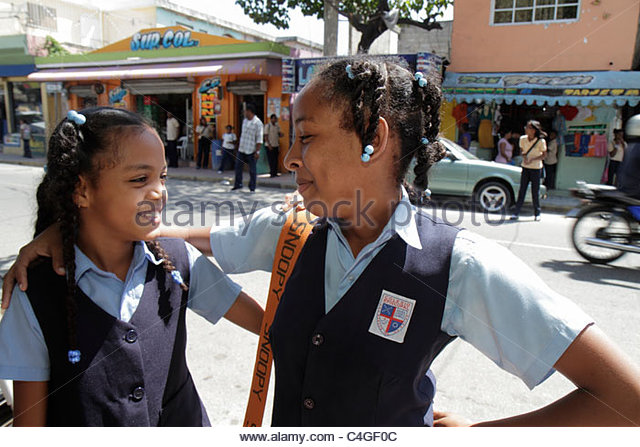 Santo Domingo Dominican Republic Bajos de Haina Hispanic student Black girl child sister sibling private school - Stock Image