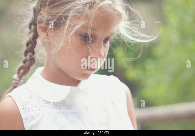 Portrait of a girl looking pensive - Stock Image