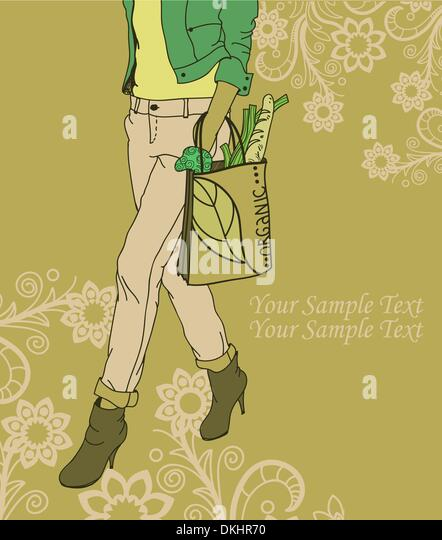 Fashion girl with a bag of organic products on a floral background - Stock Image