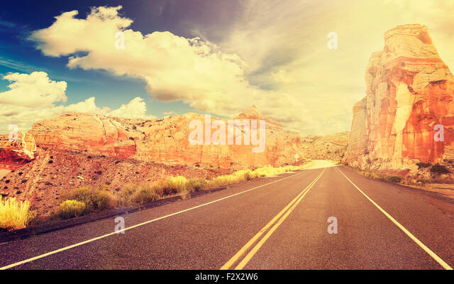 Retro vintage style mountain road at sunset, travel adventure concept, USA. - Stock-Bilder