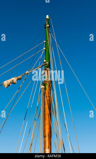 Abstract detail of a wooden sail boat mast in Brittany, France - Stock Image