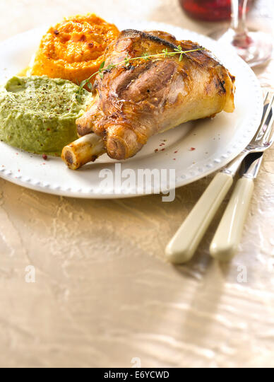 Caramelized knuckle of lamb,broad bean puree and carrot puree - Stock Image