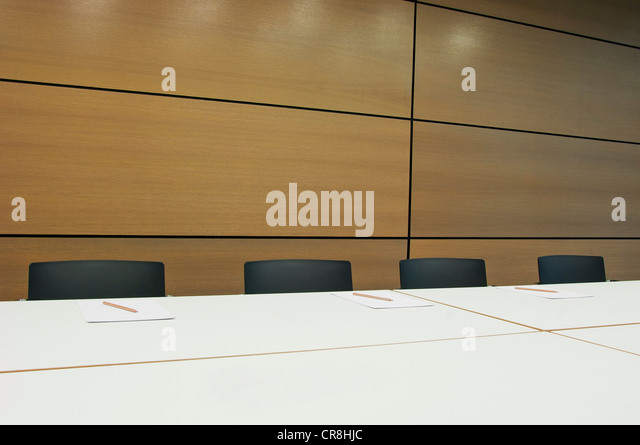 Conference table in empty office block - Stock Image