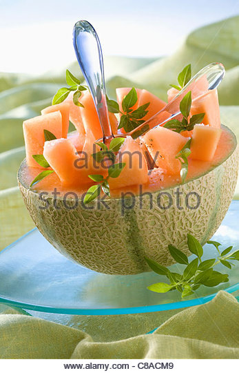 Melon salad served in half a melon - Stock Image