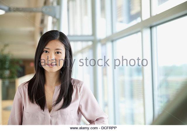 Portrait of beautiful businesswoman in office - Stock Image