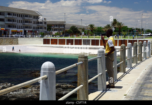 Sea Point Promenade with the town beach in the background, Cape Town - Stock Image