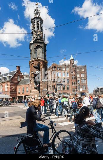 Munplein bicycles pedestrians, Amsterdam, Netherlands - Stock Image