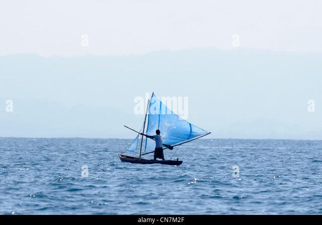Dominican Republic, Samana peninsula, fisherman in boat in the bay of Samana - Stock Image