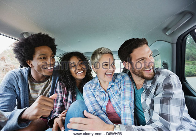 Cheerful friends enjoying road trip - Stock Image