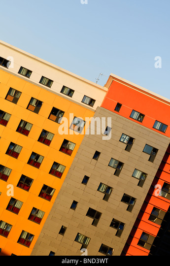 Dynamic view of modern colourful architecture of apartments in a typical British city - Stock Image
