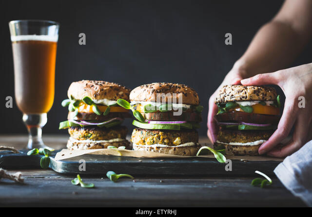 Spiced Zucchini, Feta and Chickpea Veggie Burgers with Minted Yogurt Sauce - Stock Image