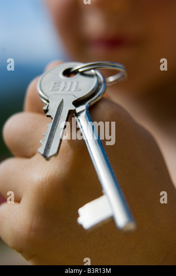 child with keys - Stock-Bilder