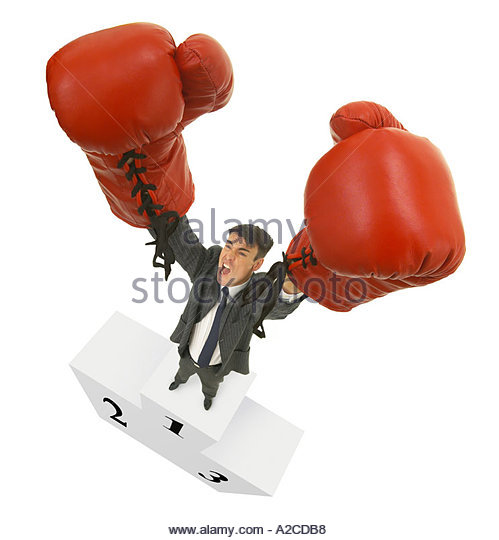 Businessman with boxing gloves wide angle - Stock Image