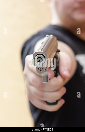 Revolver gun pointing at camera