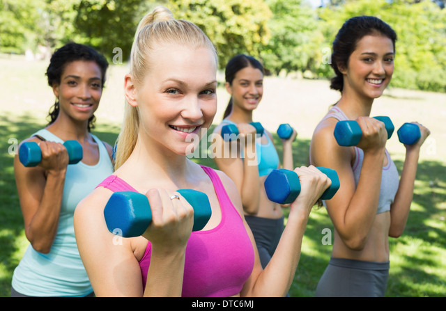 Multiethnic sporty women weightlifting - Stock Image
