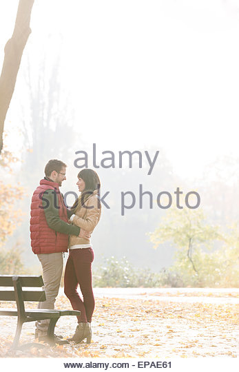 romance heterosexual couple autumn park - Stock-Bilder