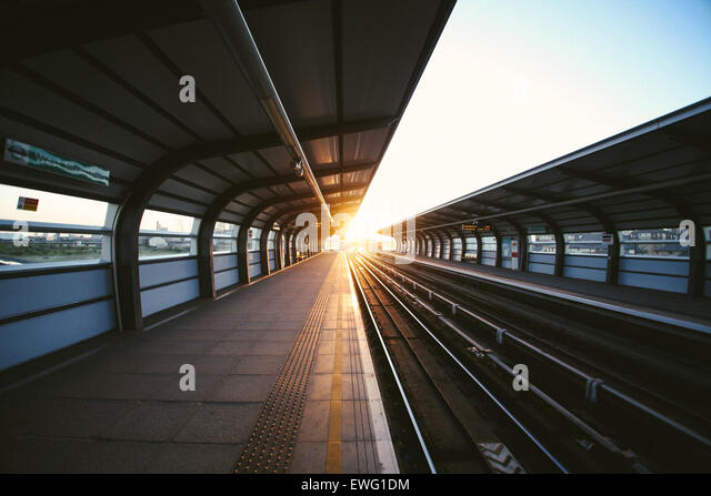 Outdoor Train Station at Sunset - Stock Image