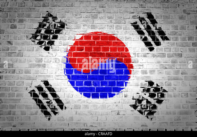 An image of the South Korea flag painted on a brick wall in an urban location - Stock Image