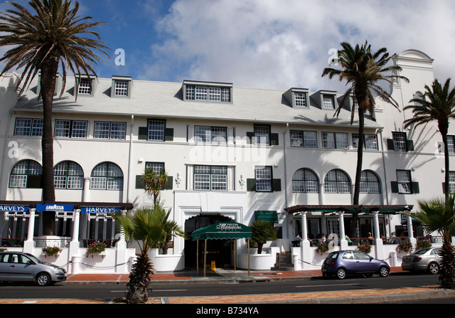 entrance of the winchester mansions hotel and harvey's bar along beach road sea point cape town south africa - Stock Image