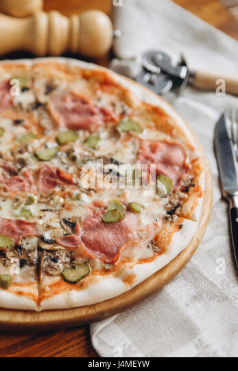Pizza pie on table - Stock-Bilder