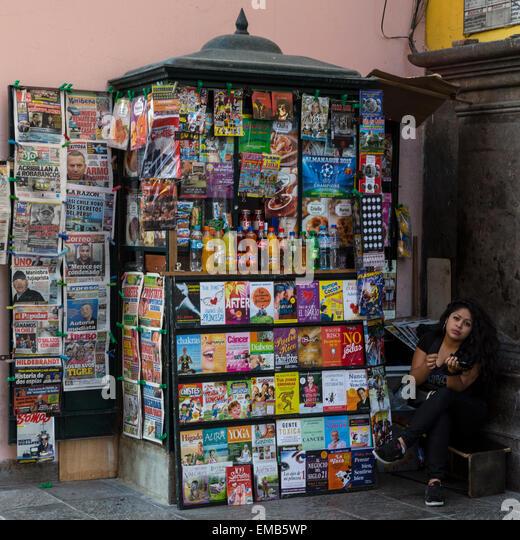 Peru, Lima.  Woman and Newsstand. - Stock Image