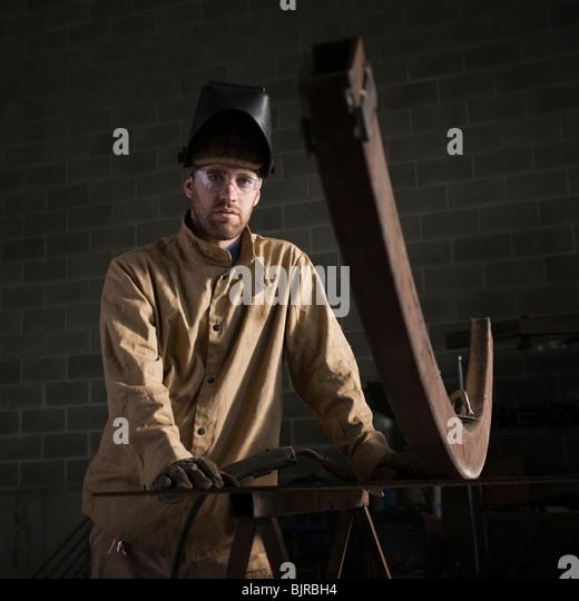USA, Utah, Orem, portrait of male welder in workshop - Stock Image